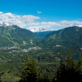 Whistler and Blackcomb mountains on a summer day. Tourism Whistler/Mike Crane