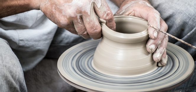 Potter throwing clay
