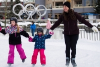 Family skating Whistler Olympic Plaza. Credit: TW/Mike Crane