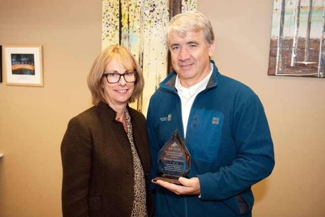 Michael Hutchison receives his Civic Service Award from Mayor Nancy Wilhelm-Morden.