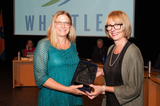 Sharon Schrul receives her Civic Service Award from Mayor Nancy Wilhelm-Morden.