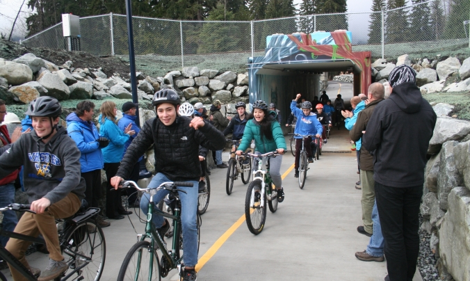 Whistler Secondary School students ride through the tunnel