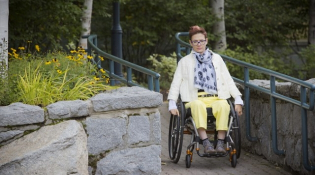 Photo woman in a wheelchair travels down a ramp in Whistler Village