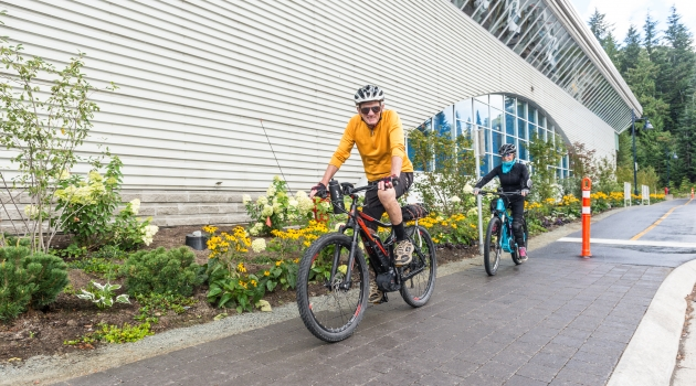 Biking on the Valley Trail in front of Meadow Park Sports Centre image by Scott Brammer